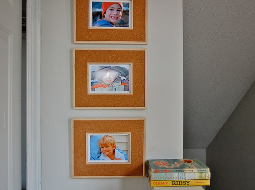 framed photos in the playroom